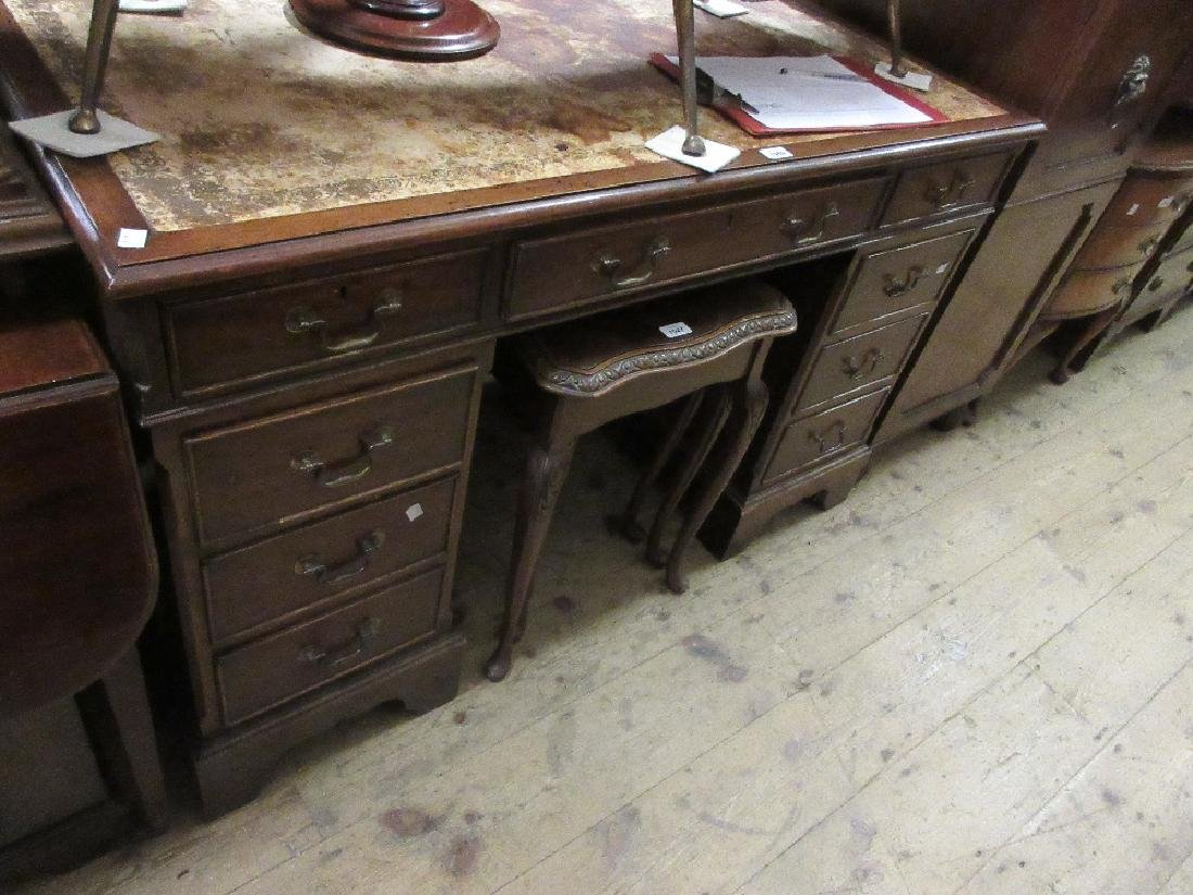 Reproduction mahogany twin pedestal desk with a leather