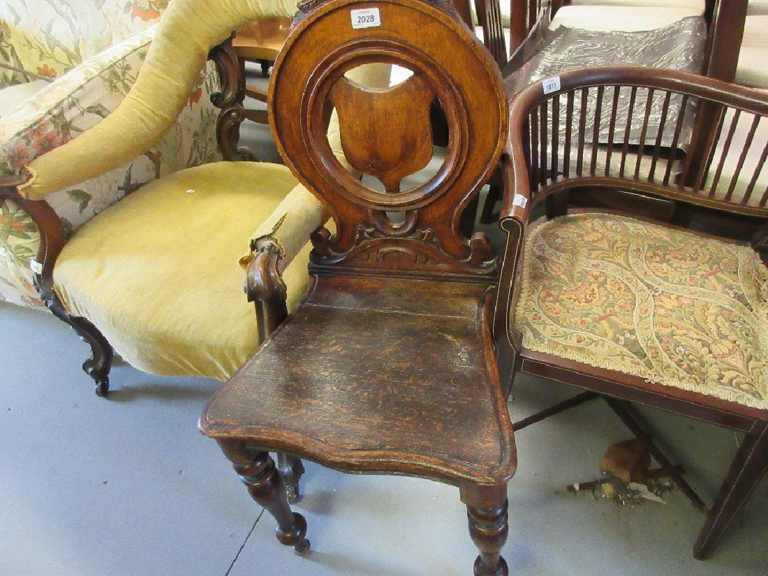 19th Century oak hall chair having floral carved and