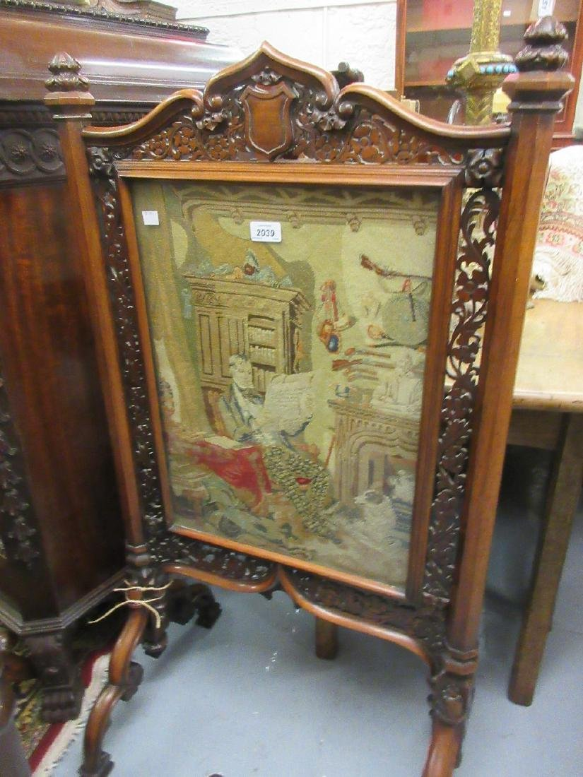 Victorian rosewood Gothic revival firescreen with a