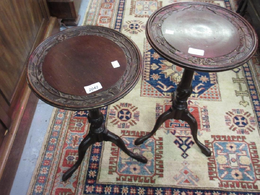 Pair of mahogany wine tables with carved dish tops