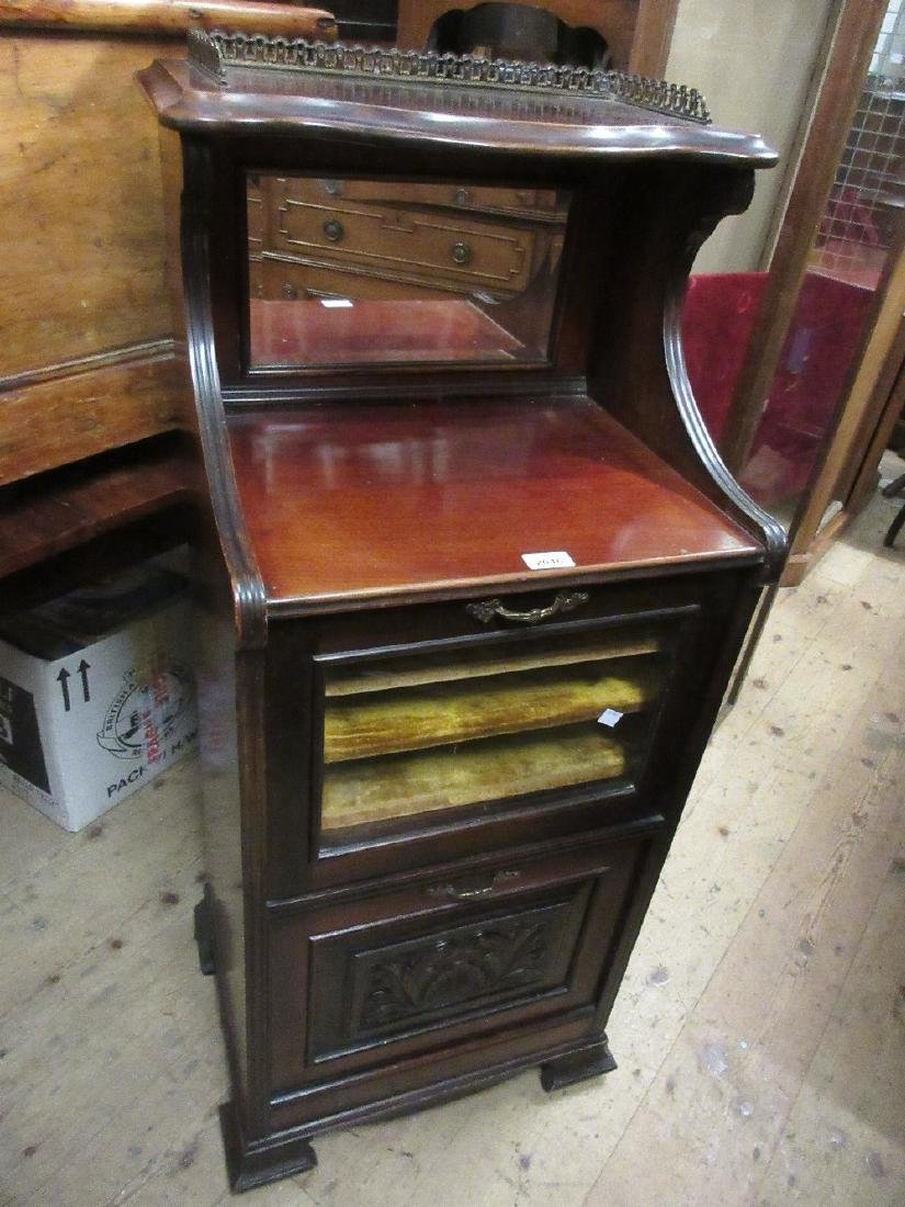 Edwardian mahogany music cabinet with a mirrored