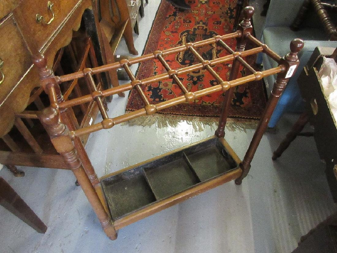 Edwardian mahogany twelve division stick stand with
