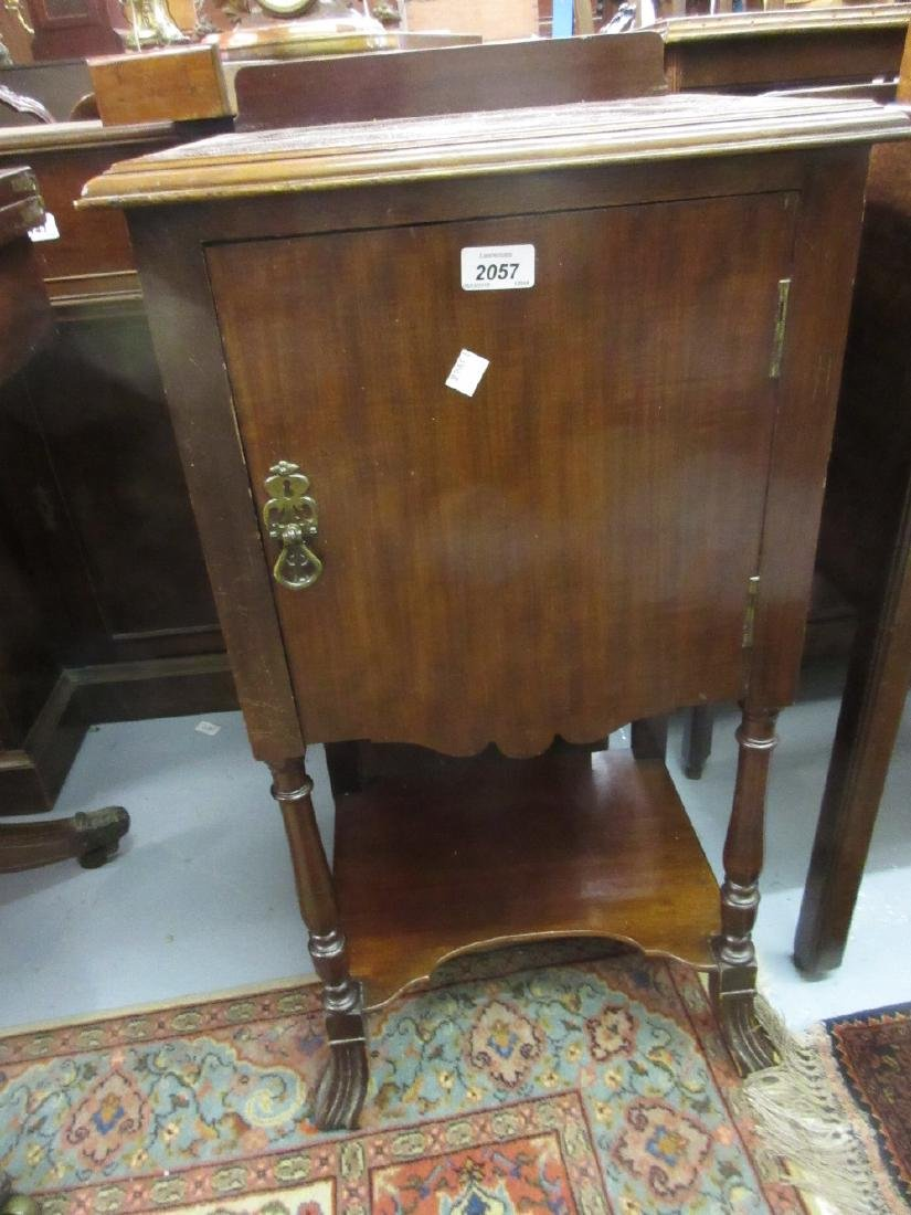 Mahogany bedside cabinet with single door on turned