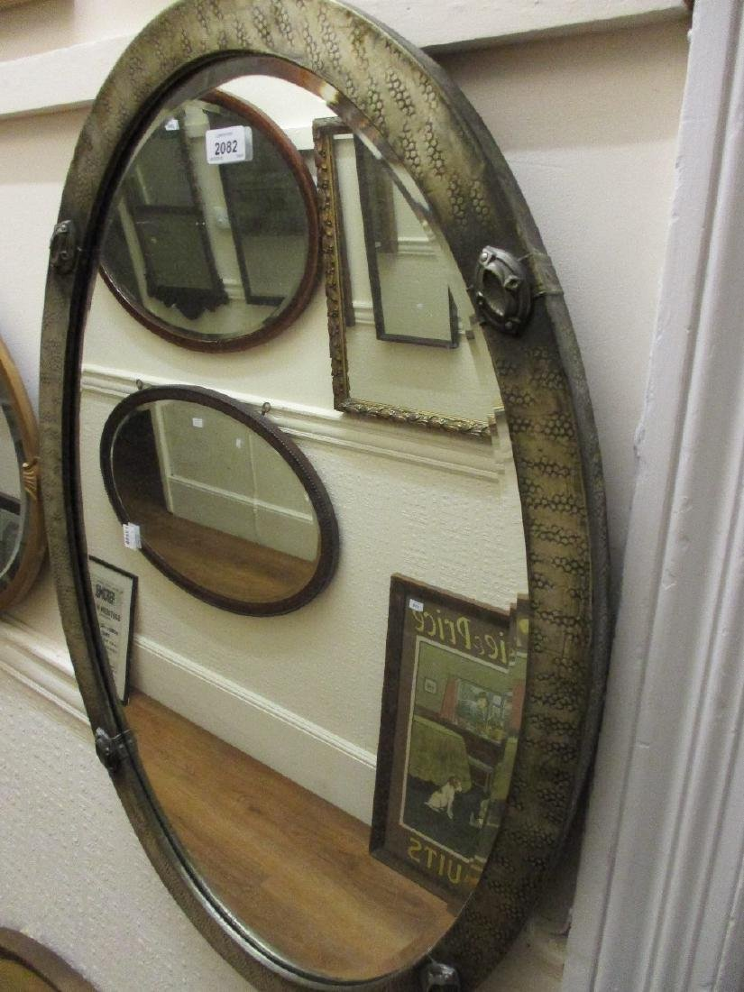 Art Deco oval silvered metal framed wall mirror with