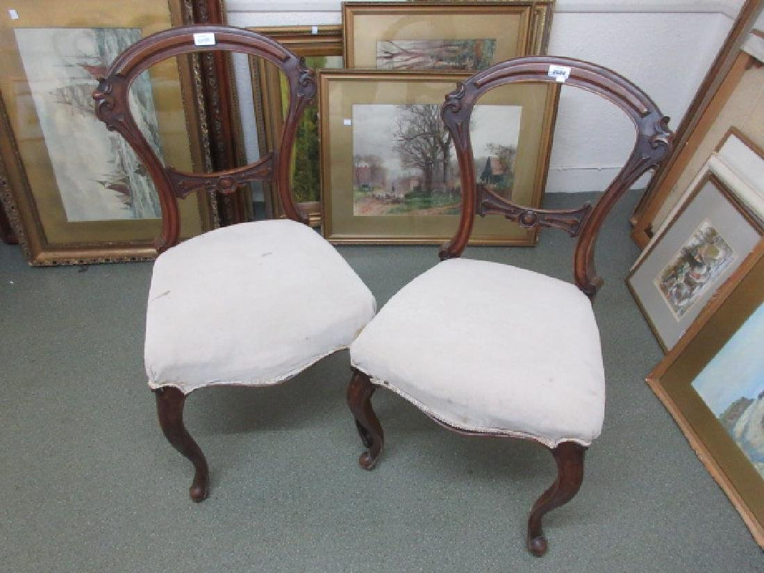 Pair of Victorian walnut balloon back side chairs on