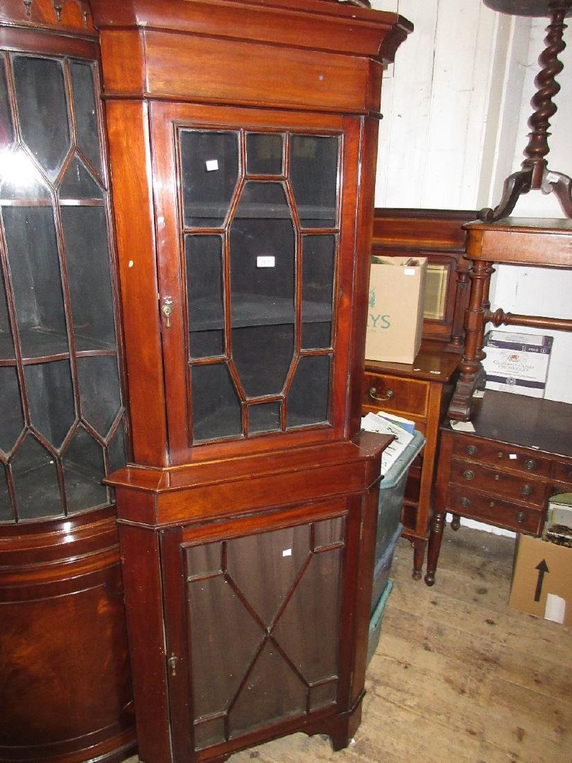 Edwardian mahogany floor standing corner cabinet with a