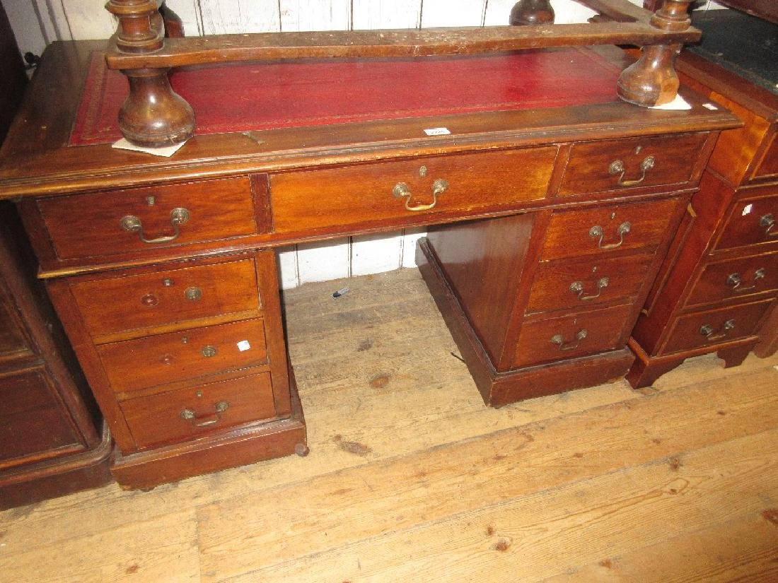 Edwardian mahogany twin pedestal desk with a leather