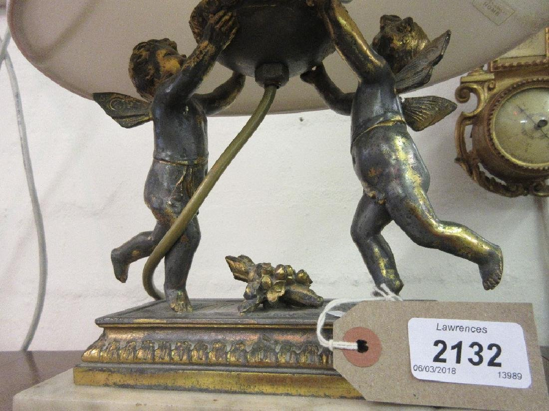 Gilded spelter lamp base in the form of winged cherubs