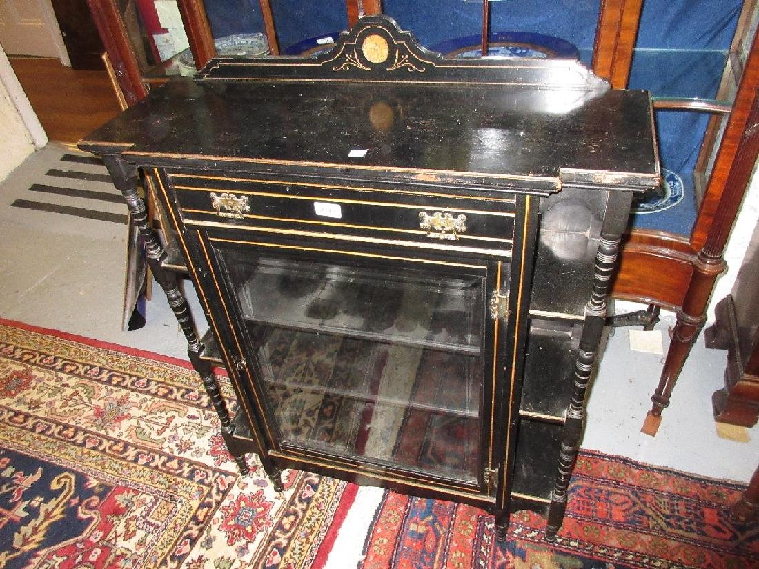 Small late Victorian ebonised single door display