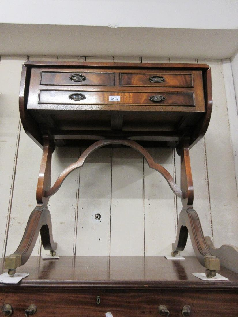 Reproduction mahogany drop-leaf occasional table with