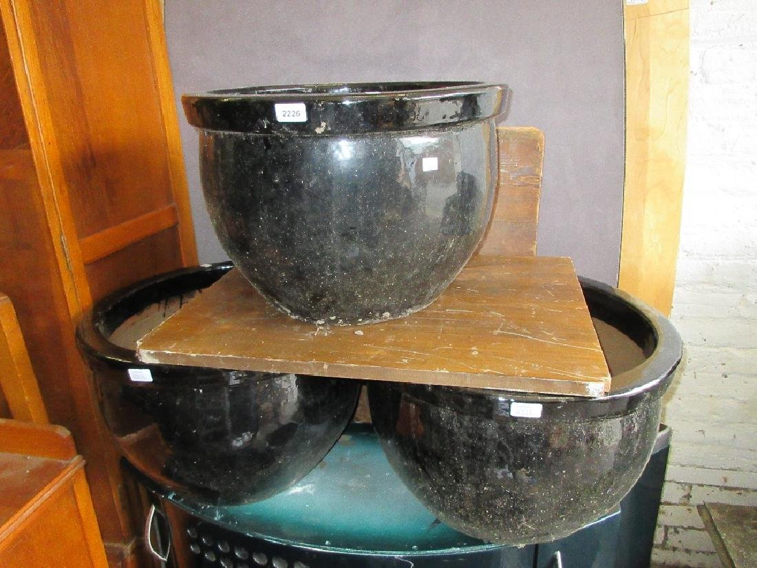 Three large modern black glazed pottery garden planters