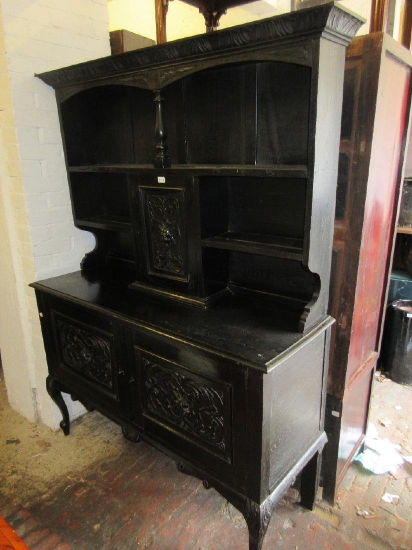 19th Century carved and ebonised oak dresser, the shelf