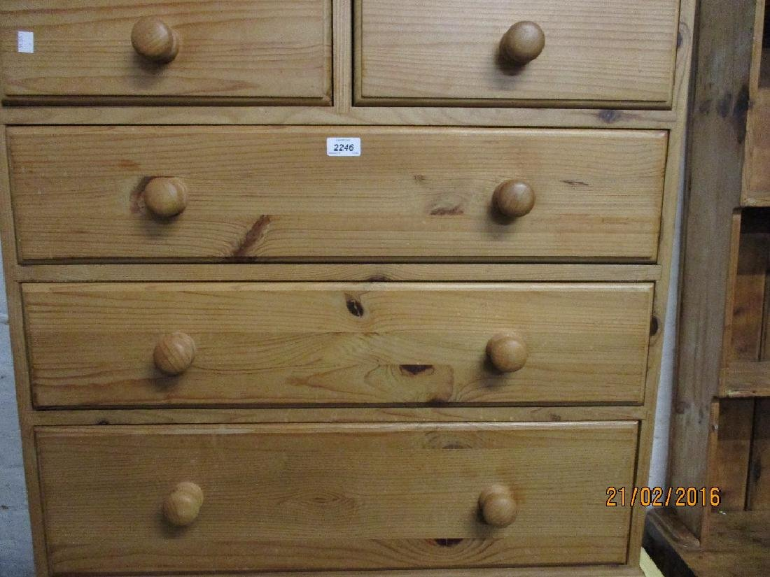 Modern pine chest of two short over three long drawers