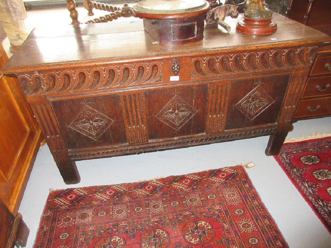 17th Century oak coffer, the plank top over three panel