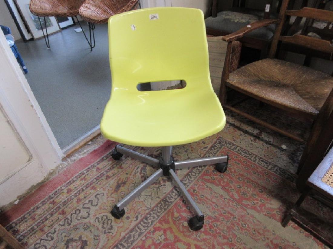 Modern yellow injection moulded swivel office chair in