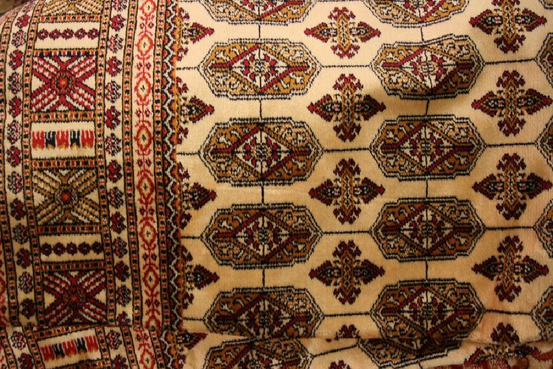 Beige ground Bokhara pattern machine rug, 1.9m x 1.4m