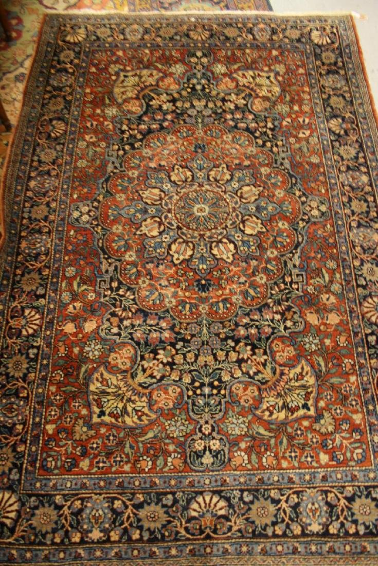 Tabriz rug with a medallion and all-over stylised
