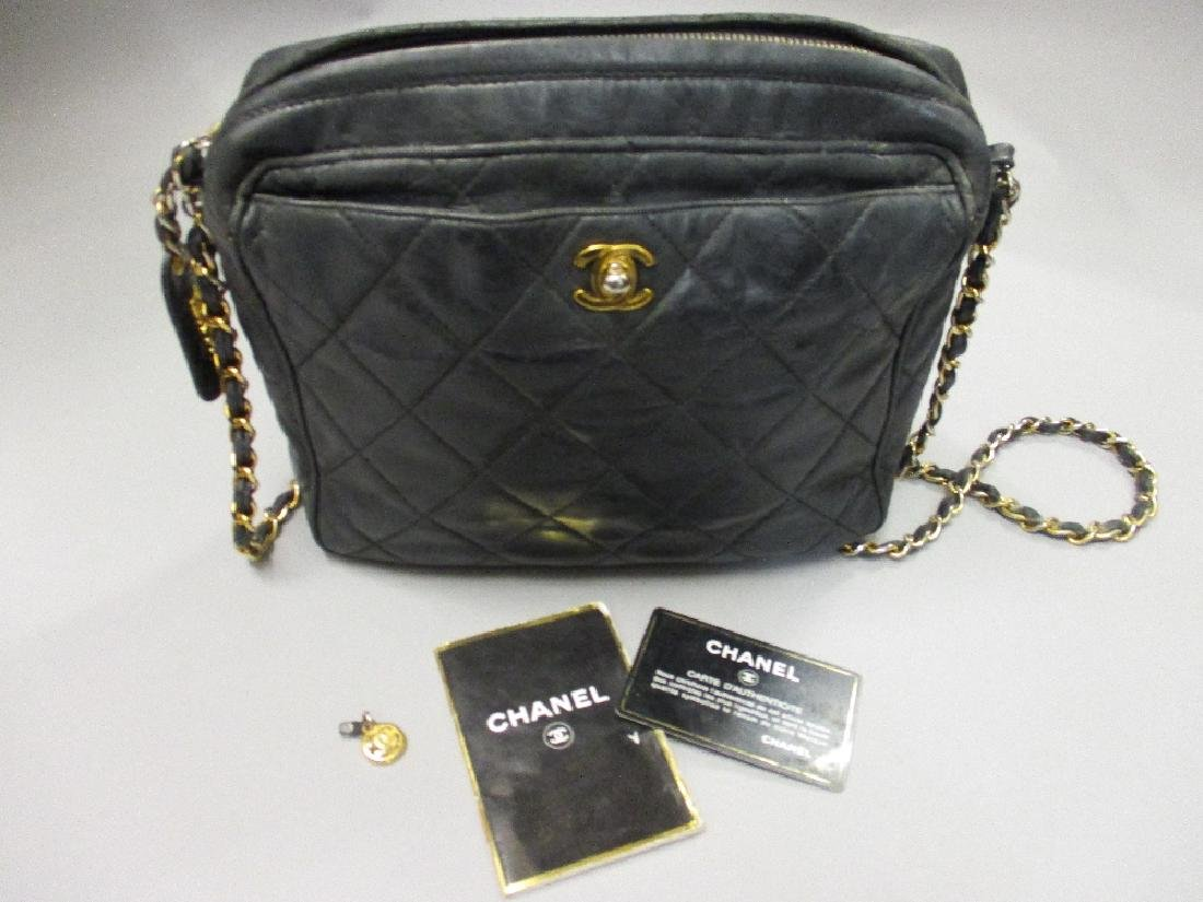 Ladies black quilted leather handbag by Chanel with