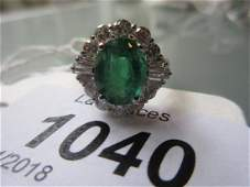 18ct White gold emerald and diamond cluster ring, the