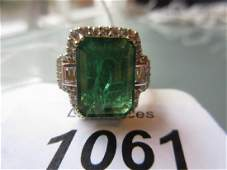 18ct Yellow gold emerald and diamond ring, the emerald