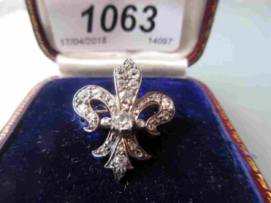 Edwardian gold diamond set fleur-de-lys brooch, housed