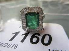18ct White gold emerald and diamond set ring the