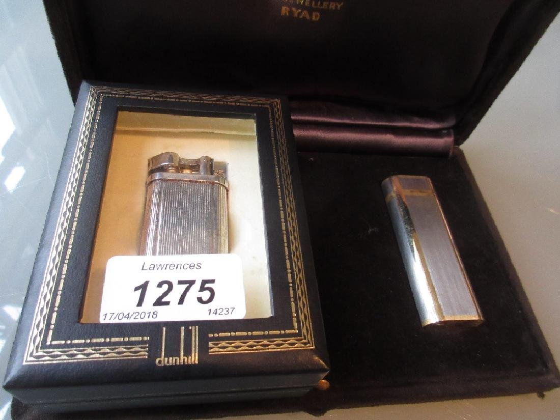 Dunhill silver plated cigarette lighter together with a