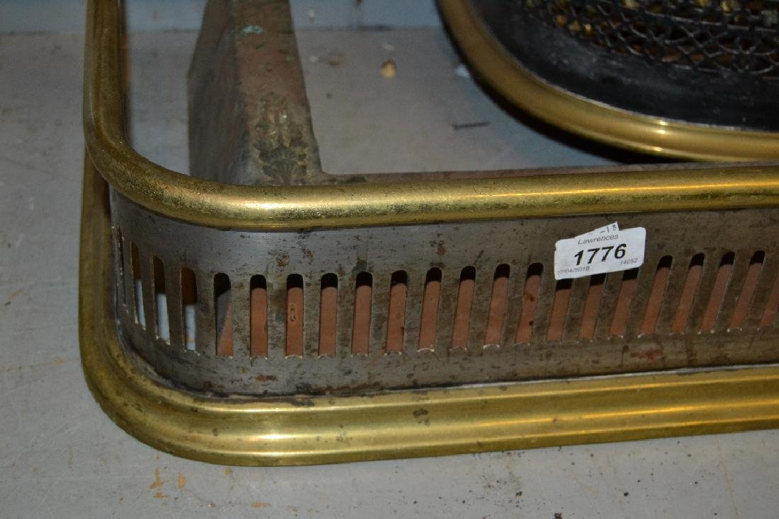 19th Century pierced brass fender, steel spark guard,
