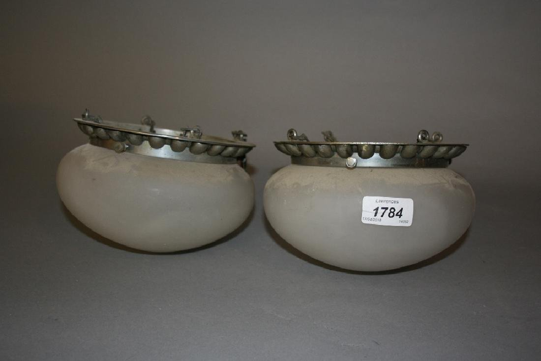 Two small opaque glass light bowls, a star form light