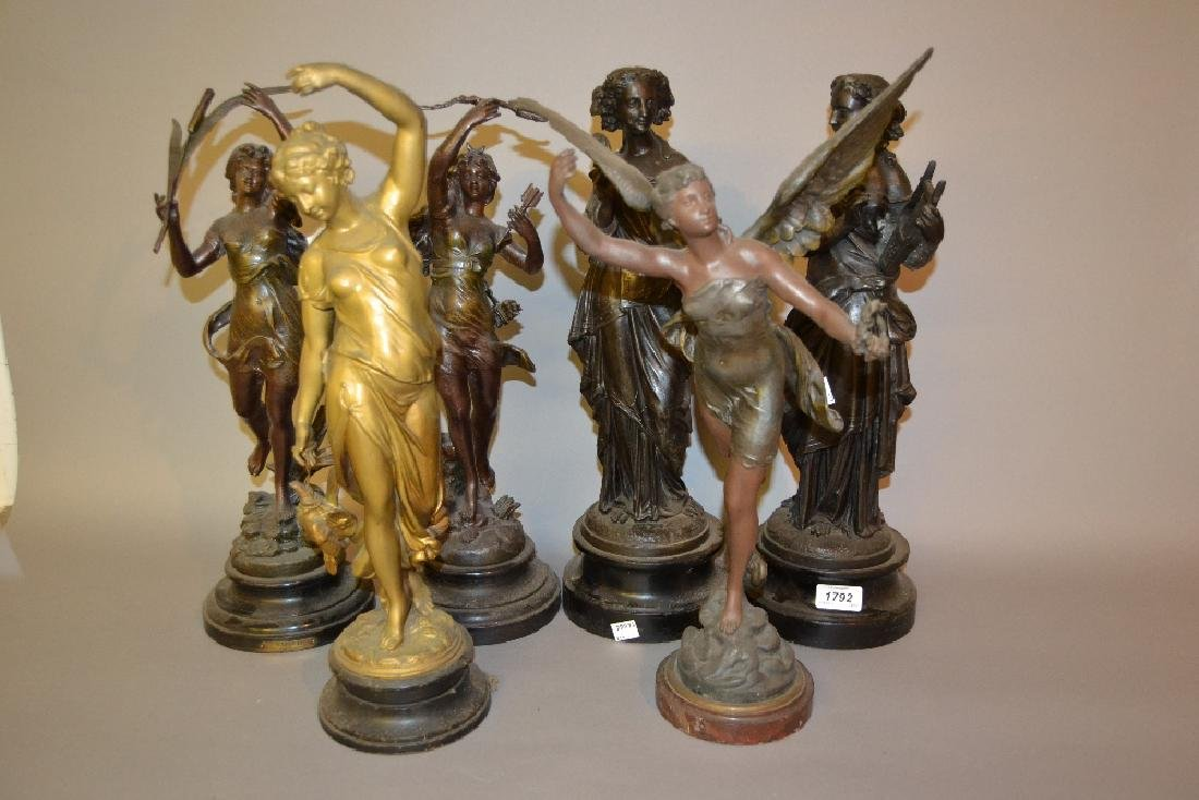 Two pairs of patinated spelter figures, together with