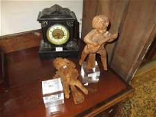 Pair of carved wooden cherub musician figures, mounted
