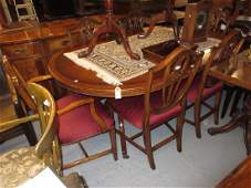 Good quality reproduction mahogany dining room suite by