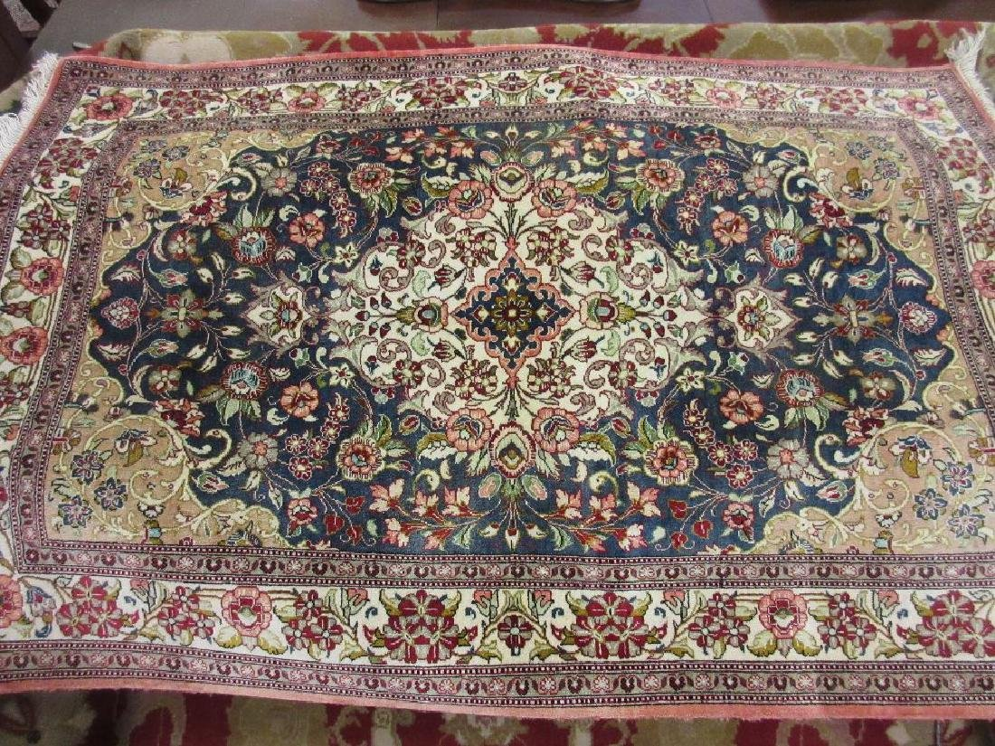 Small Turkish part silk rug with centre medallion,