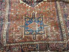 Karaja rug having a row of three hooked medallions and