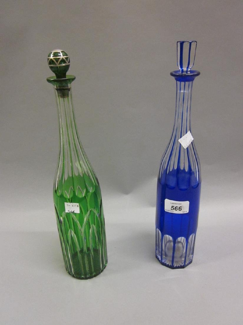 Two Bohemian overlaid clear glass decanters in blue and