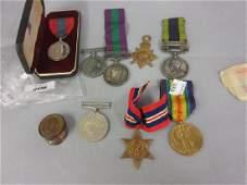 Group of four medals, George V, George VI and Elizabeth