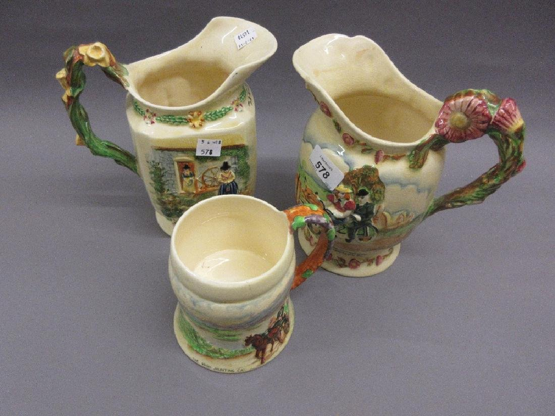 Two Crown Devon musical jugs and a similar jug