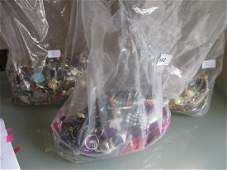 Three clear plastic bags containing a large quantity of