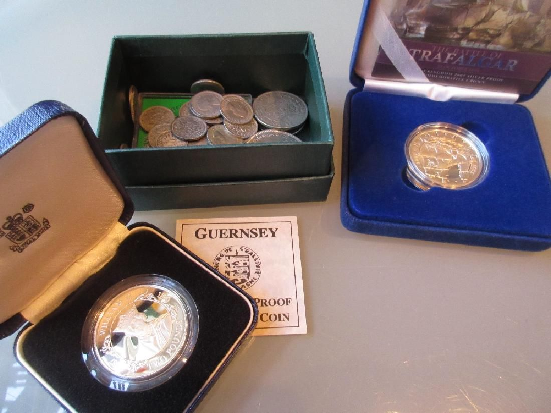Small box containing a quantity of various coins
