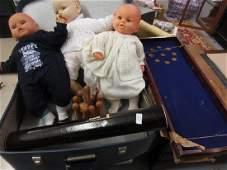 Blue case containing modern dolls, shove ha'penny