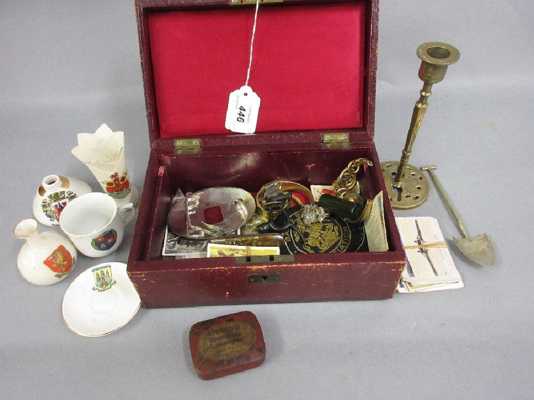 Red leather jewellery box containing a quantity of