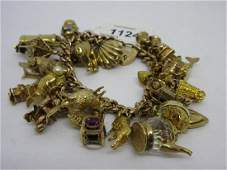 Large and heavy 9ct gold curb link charm bracelet with