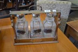Late Victorian oak brass mounted three bottle tantalus