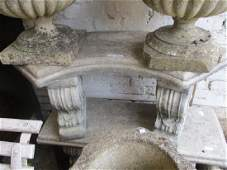 Cast concrete curved garden bench together with a