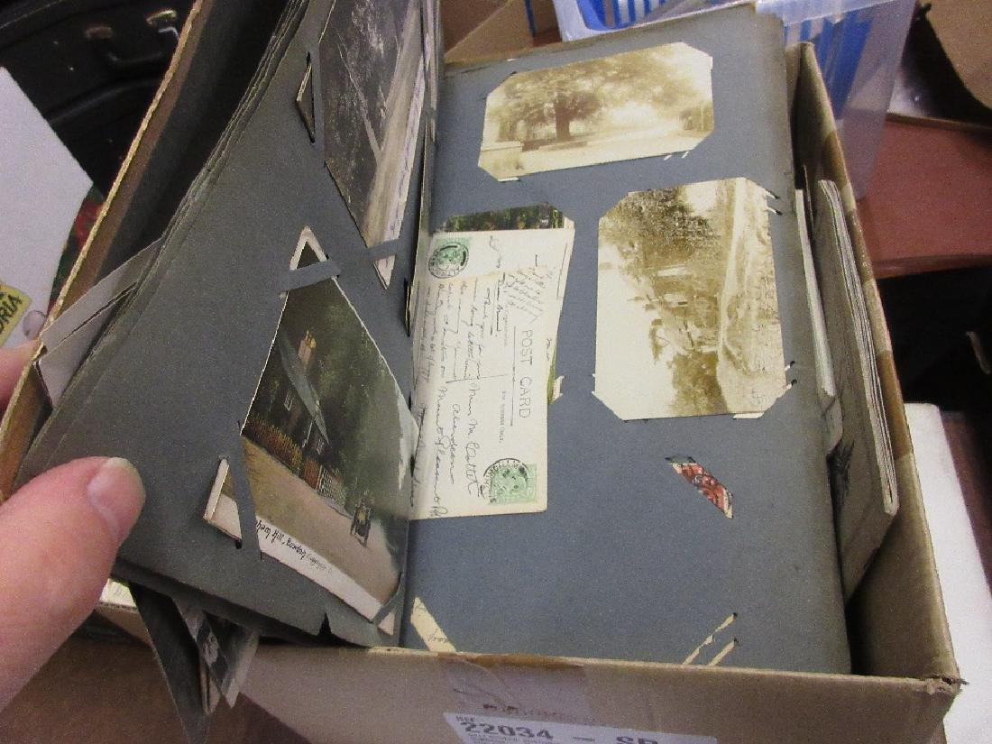Album containing a collection of postcards together
