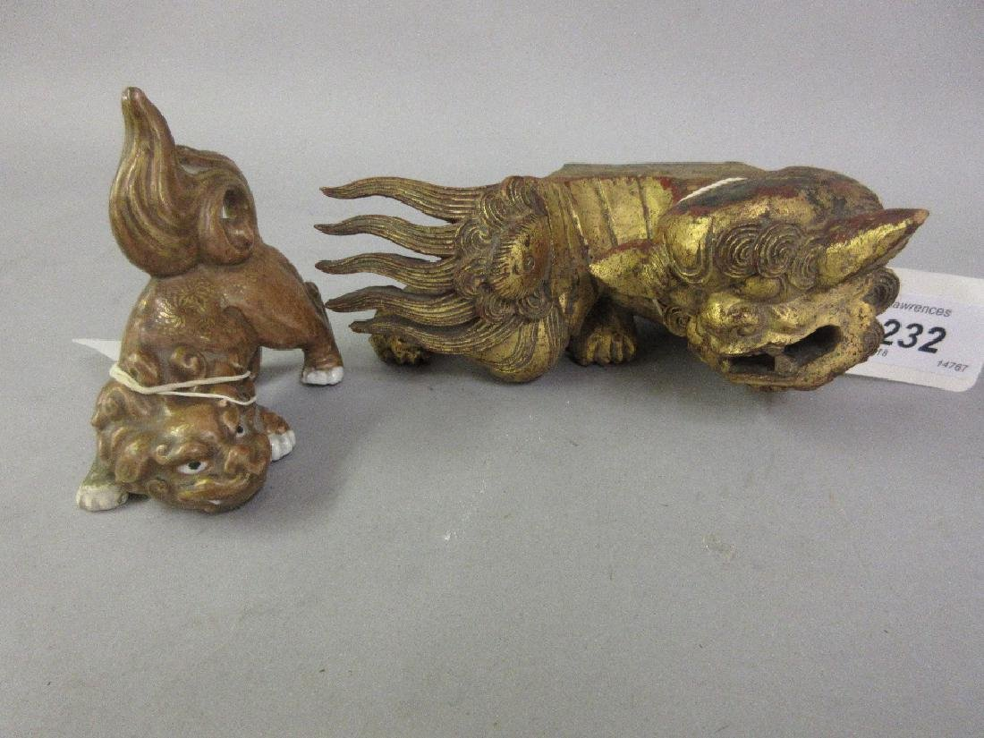 Oriental carved and gilded figure of a dog of foe