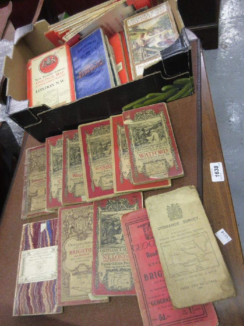 Box containing a collection of Ordnance Survey maps of