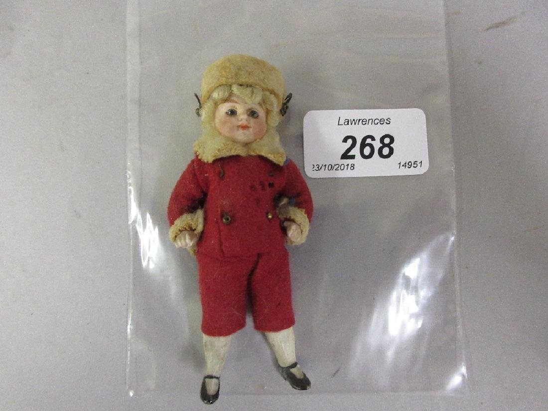 Miniature bisque 19th Century doll with red felt