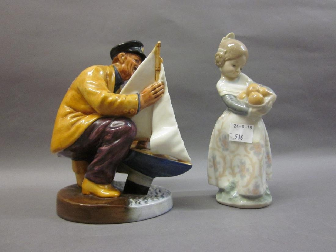 Lladro figure of a girl together with a Doulton figure,