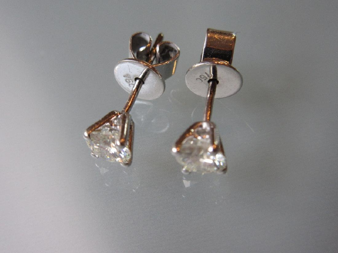 Pair of small diamond solitaire ear studs with white